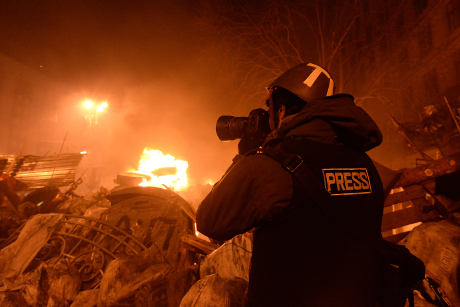 Journalist documenting events at the Independence square. Clashes in Ukraine, Kyiv. Events of February 18, 2014.